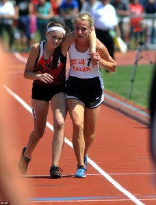 Meghan Vogel assists Arden Mcmath finish race